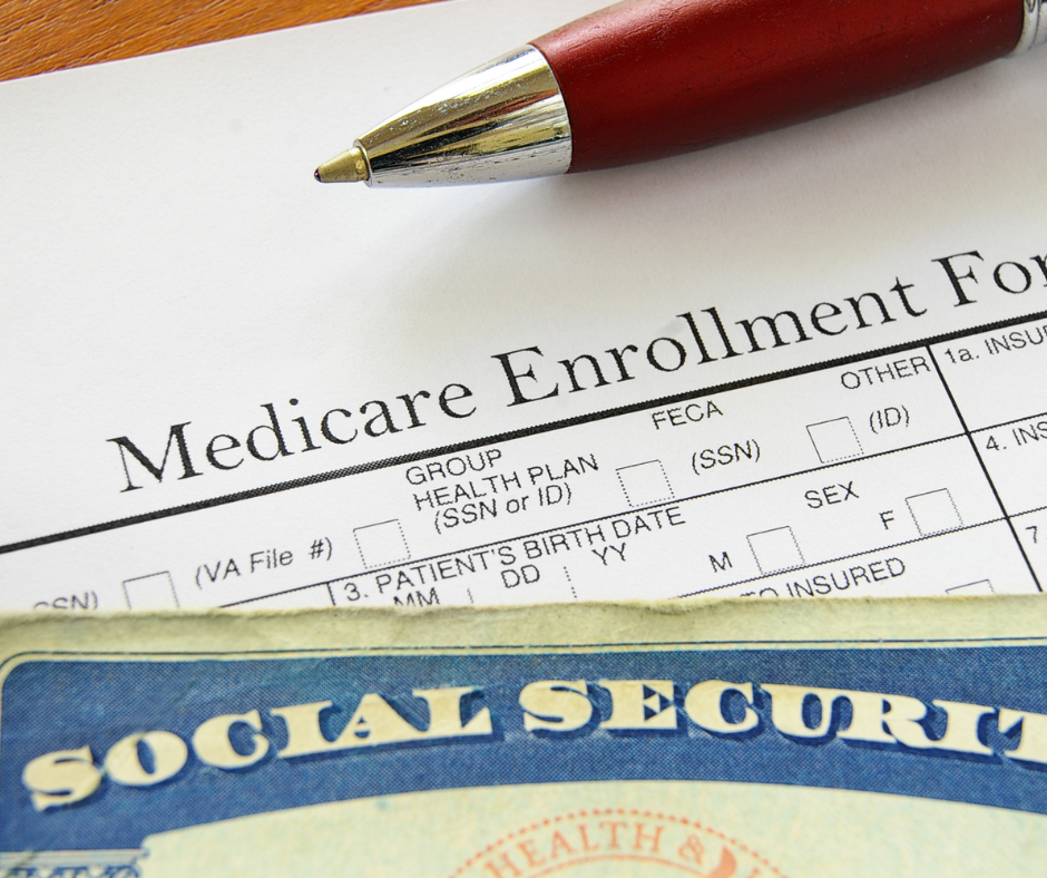 Medicare Enrollment Paperwork with pen